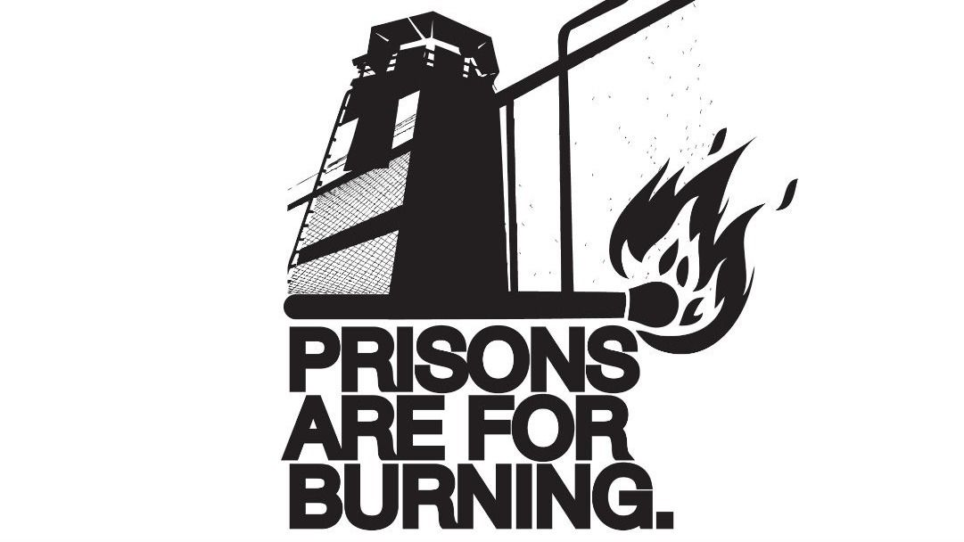 "text ""prisons are for burning"" with a lit match under a guard tower"